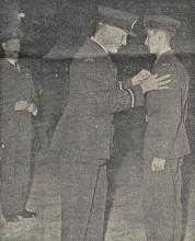 Plt Off Lew Mose receives his Wings.  Flt Lt Cooke QFI RAF looks on.