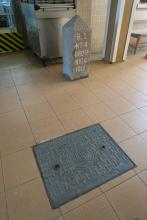 Manhole Cover & Boundary Stone, St John Hospital