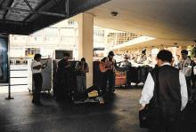 Andean musicians by ferry entrance