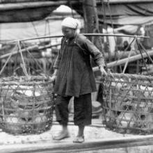 Woman carrying baskets