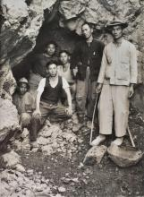 Chinese workers posing at the entrance to their mine
