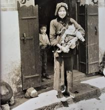 Chinese peasant woman holding a child in the New Territories