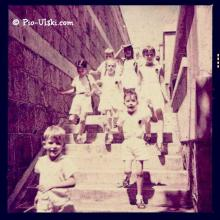 1954 running down the steps of Quarry Bay School