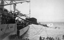 Report from Bias Bay-009-loading onto HMS Belfast