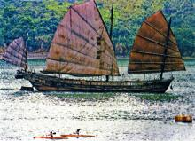 Sailing Junk between the old Castle Peak Road and Tsing Yi Island near Tuen