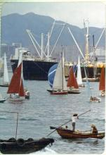 Boats racing in the crowded Hong Kong Harbor