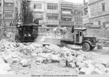 Hong Kong, men working in the middle of building rubble