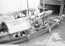 Hong Kong, women and children on boats in a harbor