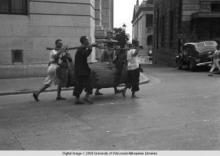 Hong Kong, men carrying a load with a yoke