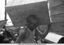 Hong Kong, man carrying cargo