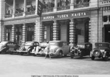 Hong Kong, cars parked in front of a building