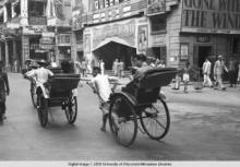 Hong Kong, rickshaws in front of the Queen's Theater