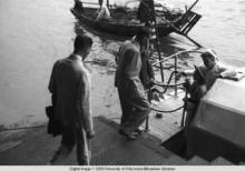 Hong Kong, American evacuees boarding boat with sailors during World War II