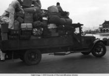 Hong Kong, truck with luggage during American evacuation