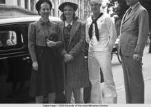 Hong Kong, American evacuees and a sailor outside the National City Bank of New York