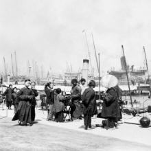 1901. People & boats along the new Praya