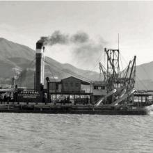 """Wesselingh family archive: dredger """"Portugal"""" in Hong Kong, Causeway Bay Reclamation, 1953"""