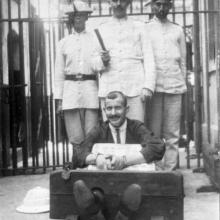 1910s Posed Photo of Policeman in Stocks