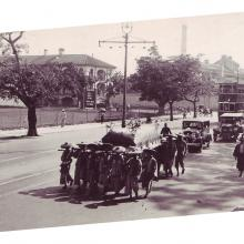 1930s Funeral procession passing cricket pitch