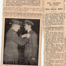 G C Randall receives wings (newspaper clippings)