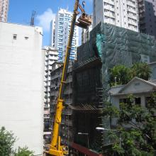 Dropping in an excavator to demolish an old building