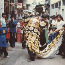 Lion Dance in the market streets, Chinese New Year