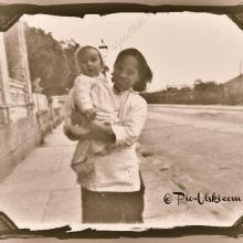 1948 Me with my baby amah whose name I know not.jpg