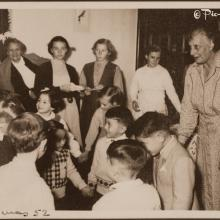1952 Christmas - Miss Fleuty with her charges