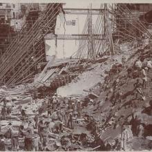 Workers clearing away the debris of the collapsed retaining wall and houses at Po Hing Fong in July 1925