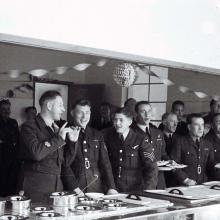 Officers serving meal b