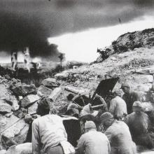 Japanese troops of the 10th Independent artillery brigade attack North Point. 1941