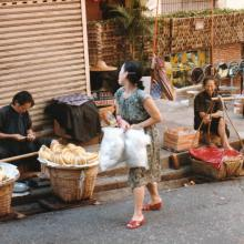 Fruit sellers with poles.