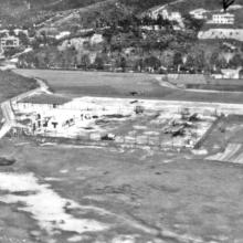 Hong Kong-RAF Shatin-3 Austers in compound & 1 taking off-see shadow on runway-1960