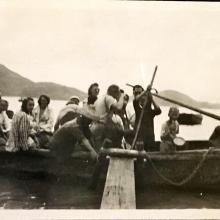 'Homeward Bound!' from Sunset Peak, Lantau Island. Douglas Crozier sits to left (white shirt). 6th from left may be Gladys Fisher. August 1948. Copyright Crozier family.
