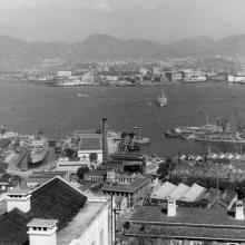 Over HMS Tamar to Kowloon.