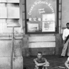 Hong Kong, men sitting on the sidewalk