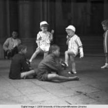 Hong Kong, children getting their shoes shined