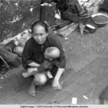 Hong Kong, woman with baby