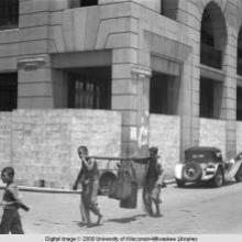 Hong Kong, boys with buckets in street scene