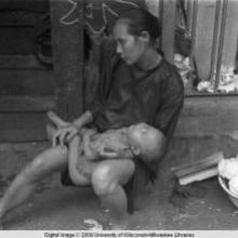 Hong Kong, woman with baby on street