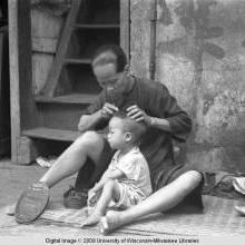 Hong Kong, woman with child on street